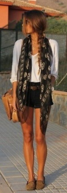MUST GET = BLACK SKULL SCARF, have a white one, need black... i love how the scarf is left loose with her hair long, kind of flows along with it... very cool