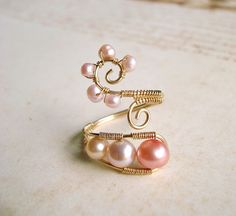 Pink Pearl Wire Ring, Gold Filled Wire Wrapped Ring With Pink Freshwater Pearls, Adjustable Wire Weave Ring. $45.00, via Etsy.