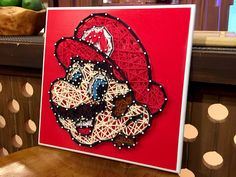 Mario - Super Mario Bros. String Art ***Handmade to Order*** by BlindScience on Etsy https://www.etsy.com/listing/386923986/mario-super-mario-bros-string-art