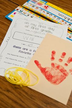"Time capsule: handprint, height measured by yarn, ""on my first day"" worksheet and self-portrait.  Finish off with ""Do Not Open Till June 2012"" sticker."