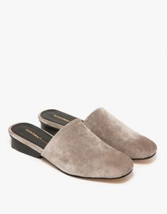 A genuine suede slip on mule from INTENTIONALLY BLANK in taupe.  Features wide round toe, leather uppers, leather lining, synthetic outsole and inset floating square heel.  •Slip on soft suede mule in taupe •Wide, round toe •Leather uppers •Leath