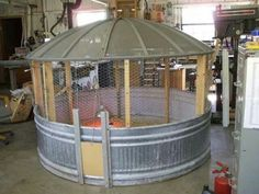 Recycled items for a chicken coop, small garden or pet area. Roof is an old satelite.  Looks easy to make.