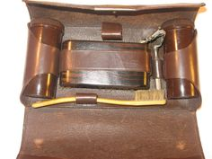 Classy Vintage 1930s Stanley Chaloner Brown Leather  Mens Grooming Kit with Bakelite Pieces. $38,00, via Etsy.
