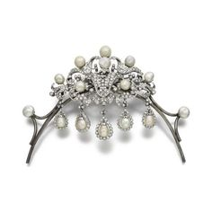 a diamond and pearl tiara/brooch combination, featuring an intricate diamond foliate scroll brooch, set with eight button pearls, with an additional button pearl at the terminal of the tiara frame, and five pear-shaped pearls suspended from it set in diamond loops
