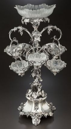 A THOMAS BRADBURY & SONS SILVER-PLATED AND CUT GLASS EPERGNE.
