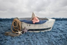 Newborn photography baby boat