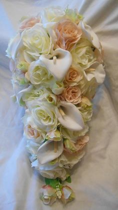 Items similar to Cascading bridal bouquet ivory with blush pink roses and diamond white calla lilies 2 pieces free small toss on Etsy Cascading Bridal Bouquets, Cascade Bouquet, Calla Lilies, Pink Roses, Blush Pink, Lily, Ivory, Weddings, Diamond