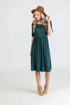 This dress features a cozy half sleeves and a flattering cinch waist that is a loose and comfy fit. It also has side pockets to add the perfect touch of trend and functionality without being too bulky. Perfection!