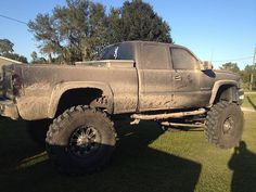 jacked up and covered with mud. just the way i like them :)