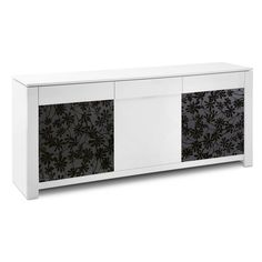 Domitalia Bass Sideboard Streamlined and cool, the Bass Sideboard features a surprising contrast in its screen printed black glass doors within a white lacquered body. The MDF lacquered frame includes two tempered glass doors with modern leaf pattern, one center MDF lacquered door and three drawers following the horizontal width of the unit's top.#EdgewoodAve #Domitalia #homedecor #furniture #modernfurniture