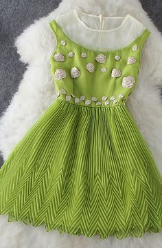 Spring green floral mini-dress {amazing chevron Fortuny pleating at the bottom of the skirt!}