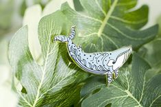 This minke whale kelp forest pin is dedicated to the beautiful minke whales of the ocean. There are two major species of minke whales, the antarctic minke whale and the common minke whale. This pin is a little closer to the antarctic version of this amazing creature and features a few