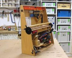 A clever tool chest hinge, and another version here: http://woodgears.ca/tool_holders/ken.html