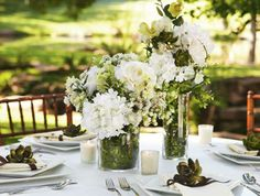 Give your wedding décor a modern allure. Fill glass vases of various sizes with an artful mix of moss and flowers.