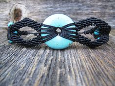 Handmade Micro Macrame Bracelet with Magnesite (Turquoise) Center Stone and Accent Beads. $55.00, via Etsy.