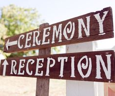 White paint on wooden stake signs points the way to the wedding ceremony and reception.