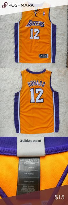 Lakers Dwight Howard Jersey The tags were removed but this jersey was never worn. I bought this for my hubby after seeing his excitement in finding out that Dwight Howard would be Joining the Lakers... which quickly turned to disgust when he left for the Houston Rockets the very next season. This would make a great gag gift for any Laker (or Dwight Howard) fan. Shirts Tank Tops