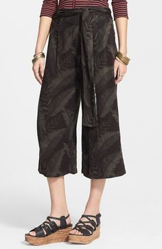 Free shipping and returns on Free People High Rise Jacquard Print Culottes at Nordstrom.com. High-waisted culottes exude a cool, casual vibe with a jacquard-woven leaf print and a flouncy waistline belt.
