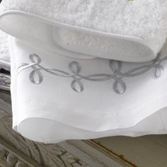 Accented with striking Grecian-inspired embroidery, this guest towel is designed to enchant with its unforgettable look and feel. Bath Linens, Guest Towels, Guest Bath, Special Guest, Towel Set, Knots, Bed Pillows, Luxury Linens, Embroidery