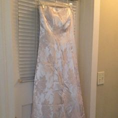 Blush pink prom dress Beautiful strapless blush pink prom dress with flower detail. Has rhinestone detail along the top of the dress. Is slightly tarnished but not very noticeable. Worn one time for prom. Needs a good press. Comes with pink shawl. Jump Dresses