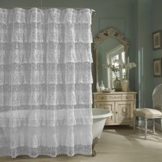 Pretty ruffled, lace shower curtain and I love the cream vanity, too~❥