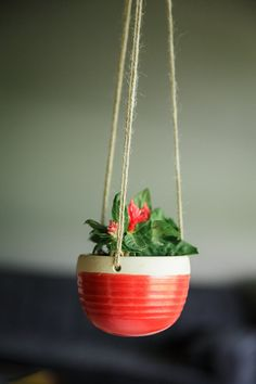 This planter is approximately 4 inches across and 3 inches deep. It is glazed in Poppy Red up to the twine holes. The lip and the interior of the