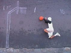 Robin Rhode is a master illusionist. Most of his art features street chalk graffiti to create an illusion of a surreal world. In a lot of his pieces, Rhode drew an object on the street in chalk, and then proceeded to interact with the drawn object as if it were real.