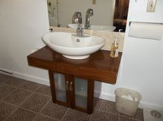 This is custom design by Alvin Head its 1/4 Teak laminated over 3/4 plywood/w 3 inset drawers