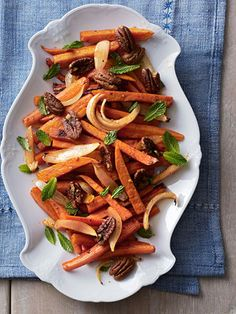 Roasted Sweet Potatoes and Carrots: Sprigs of mint are an unexpected addition to this root vegetable medley.