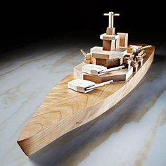 Mil-spec Iowa-class battleship woodworking plan. Whether patrolling the waves of your living room floor or anchored atop the fireplace mantle, this stately warship will make an impressive flagship for your wooden fleet.