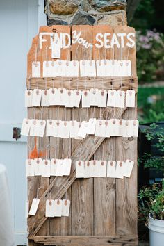 Utilize Unusual Materials - A barn door, covered with antique tags, compliments a rustic theme. Alphabetized for a large wedding or spread widely for a more intimate affair, this seating chart option is versatile and affordable. Seating Plan Wedding, Wedding Table, Wedding Blog, Wedding Reception, Our Wedding, Wedding Ideas, Wedding Inspiration, Woodland Wedding, Rustic Wedding