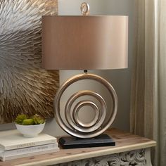 Style comes in all shapes and sizes, but we're partial to the Circles Table Lamp! This modern, metallic piece is sleek and unique and perfect for your entryway! Save 25% off on Friday (7/15) only!