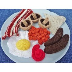 ALL DAY BREAKFAST - a pattern devised by myself. Includes pattern for egg, bacon, sausage, mushrooms, beans, toast and a dollop of sauce. great for display, decoration or as play food. if used as a toy - all play must be supervised 7 page pattern with detailed instructions and photos intermediate knitting experience required to follow pattern, some items are knitted flat and some are knitted on the round MY PATTERNS ARE COPYRIGHT PROTECTED PLEASE ONLY USE MY PATTERN FOR YOUR OWN PERSONAL USE…