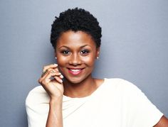 Emayatzy E. Corinealdi. This young lady is beautiful. But, look at those curls!