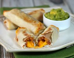 Enchilada Cheese Rolls - beans, cheese and sauce all wrapped up in an egg roll wrapper. These are addicting and just 105 calories or 2 Weight Watchers points each! Perfect as an appetizer or snack. www.emilybites.com #healthy