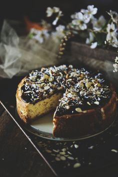This is a MUST try! Almond Joy Cheesecake Recipe - Sinful cheesecake with speckles of coconut and almonds!