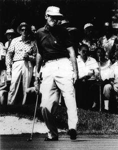 Photographer/Creator  Arthur B. Rickerby  Collection  1958  Publisher  United Press  Caption/Description  Carey Middlecoff grimaces as he misses a putt on the 6th green in the National Open Golf Tournament at the Oak Hill Country Club here.
