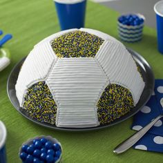 Whether you are a die-hard World Cup fan or you just like kicking a ball around the backyard with friends and family, this Go for the Goalie Soccer Cake is sure to score with soccer fans of all ages.  Colorful nonpareils help give this soccer ball cake color and texture.