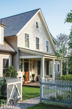 classic gray cedar shingles and white picket fence