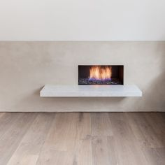 Fireplace and floating hearth. Leather House by Simon Astridge