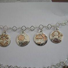 Bracciale argento con ciondoli drow