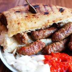 ćevapčići with ajvar, onions and kajmak