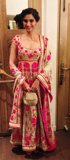 beige and pink...too much of patterns doesnt impress me..but this one sure did..the patterns are all over the anarkali and even the dupatta..looks grand