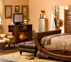 Talk about a master suite! With an accent chair, fireplace, TV, ottoman and more, you'd never have to leave this bedroom!