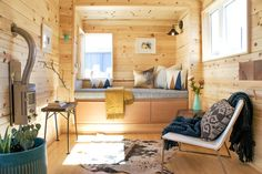 A modern/rustic version of Tru Form's Kootenay model with an all-wood interior and two loft bedrooms!