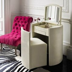 Desk that folds out into a dressing table. Super idea!