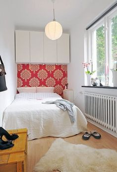 Narrow Bedroom with Pink Wallpaper and Overhead Cabinet Storage and Sheepskin Rug
