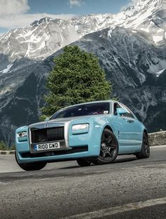 Luxury Baby Blue Rolls Royce in a beautiful Alpine background!