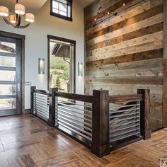 This amazing house that Shaundra Garcia from our Layton, Utah store did in last years parade of homes. Still puts a smile on my face. The chandelier pairs well with the wood work. Reclaimed Wood Fireplace, Wood Fireplace Surrounds, Fireplace Ideas, Ideas Cabaña, Decor Ideas, Future House, My House, Stair Railing, Banisters