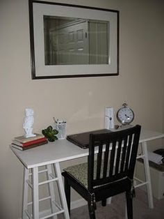 Homemade desk from 2 stools-- this would fit in the kitchen but place something over rungs of stools for additional storage shelves